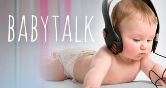 A baby wearing headphone with the 'babytalk' logo.