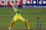 Bails fly after Alex Carey is bowled against Bangladesh.