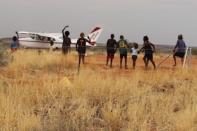 kids say goodbye to a plane