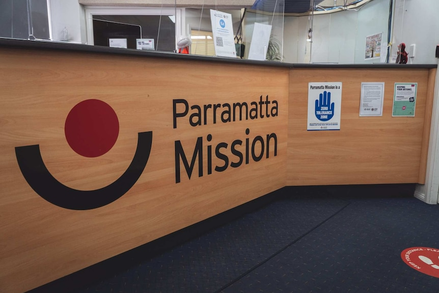 a front desk reception with the words parramatta mission emblazoned on it