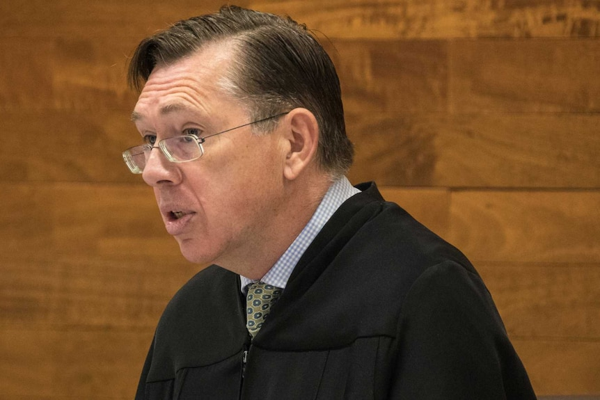 Justice Stephen Hall wearing black robes in court.