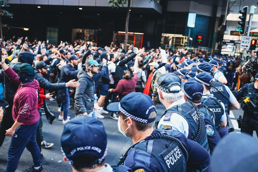 angry people standing in front of police