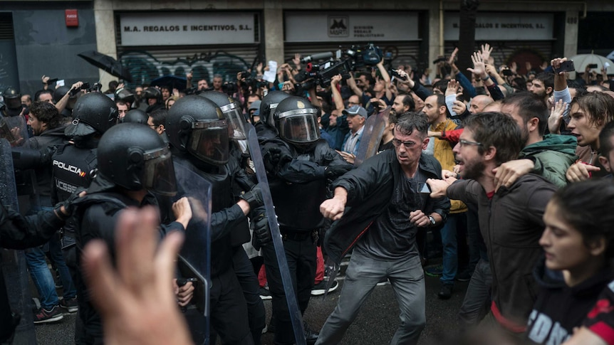 Police in riot gear clash with referendum voters outside Girona polling station (Pic: AP)