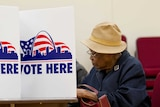 A US woman votes in Newstead