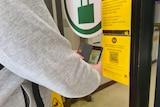 A man scans the QR code at a supermarket