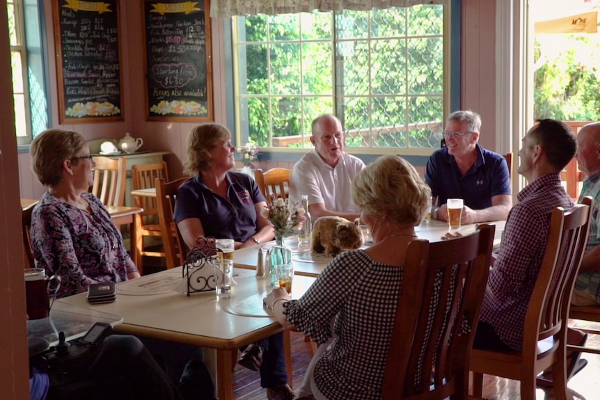 A group of pub owners sit around a table and discuss how they bought the venue.