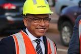 Smiling Sanjeev Gupta in a hard hat and safety vest.