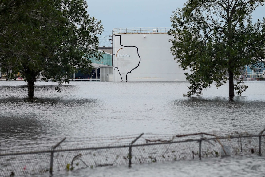 Photo taken from outside the Arkema chemical plant. The water is very high, reaching the top of a barbed wire cyclone fence.