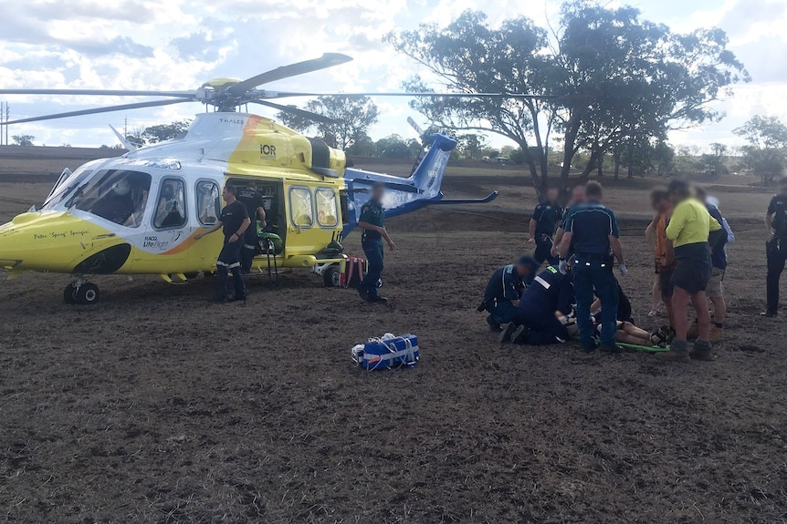 A helicopter rescues Tim Smith from an accident on his property.