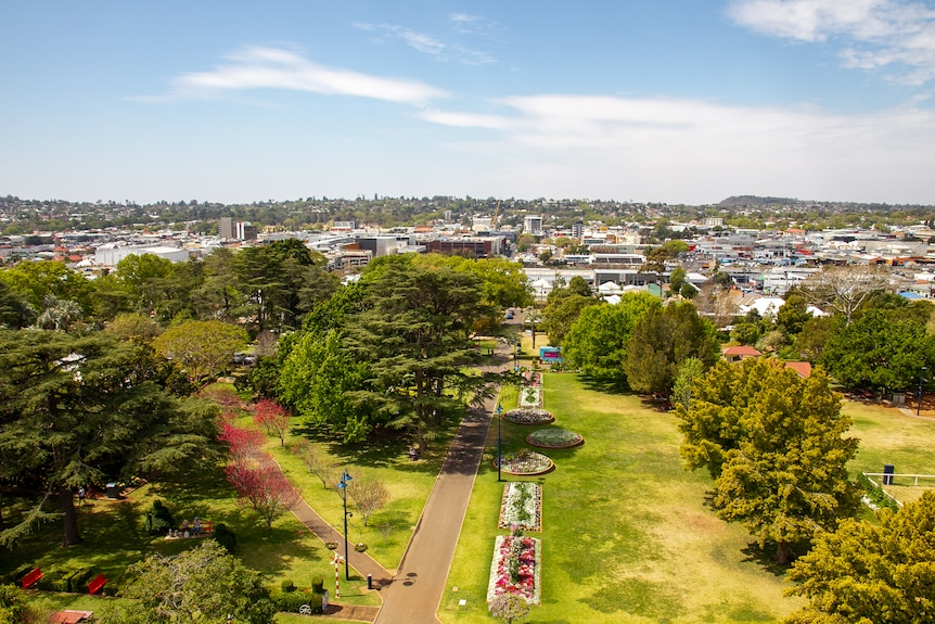 An aerial shot of Toowoomba, with a park in the foreground and buildings in the background.
