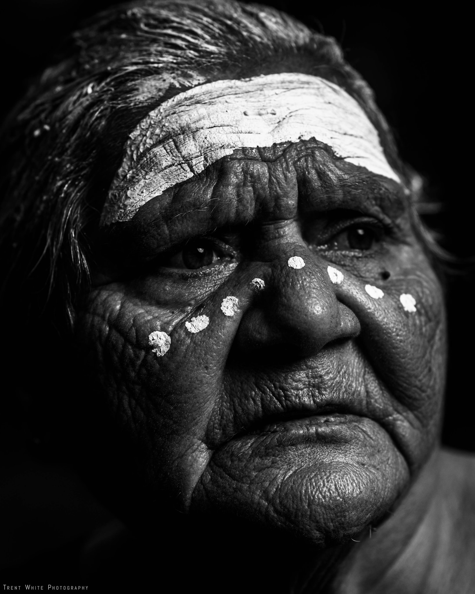 Aunty Venita Mann nee Fisher, close up, black and white, dots and lines painted on her face.