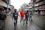 Nepalese police personnel detain a protester during a an anti-charter strike