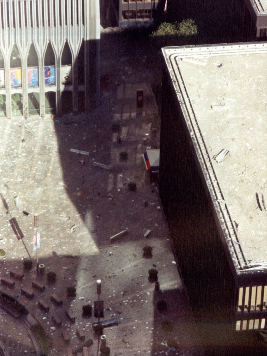 Debris lies scattered across a courtyard adjoining the World Trade Centre during the terrorist attacks of September 11, 2001.