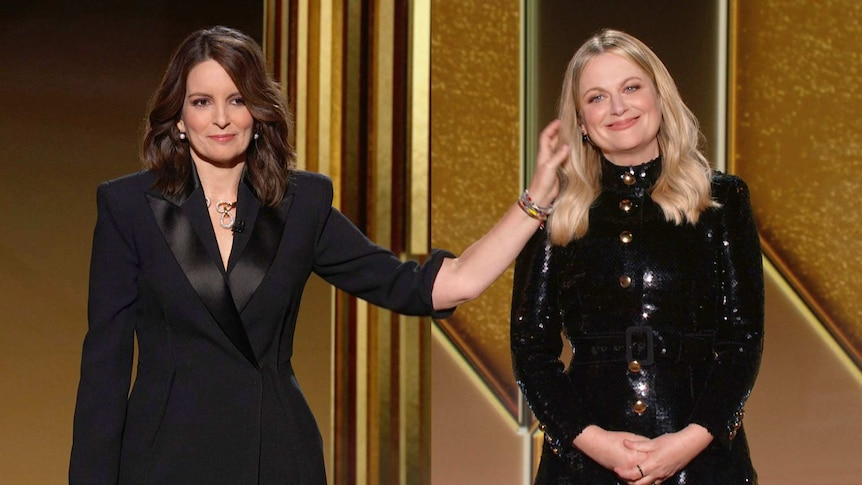 Hosts Tina Fey, left, from New York, and Amy Poehler speak at the Golden Globe Awards