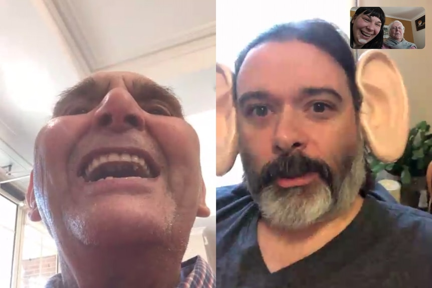 TasMihalakopoulos, 88, laughing during a video call with his family. A man on the call has big fake ears.