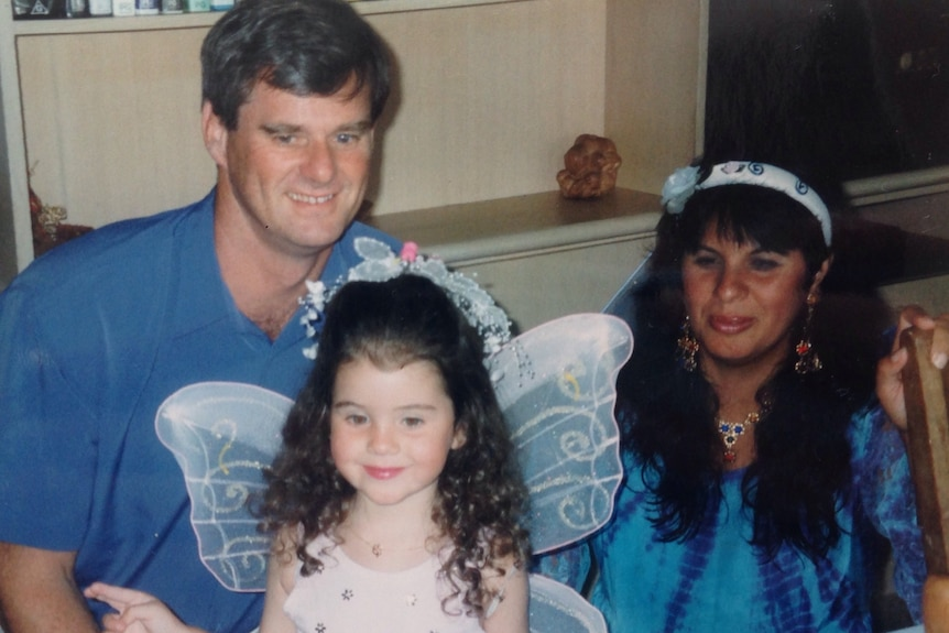 Raquel O'Brien as a little girl with her father and mother.