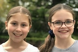 Two young girls with spots on their faces from chickenpox