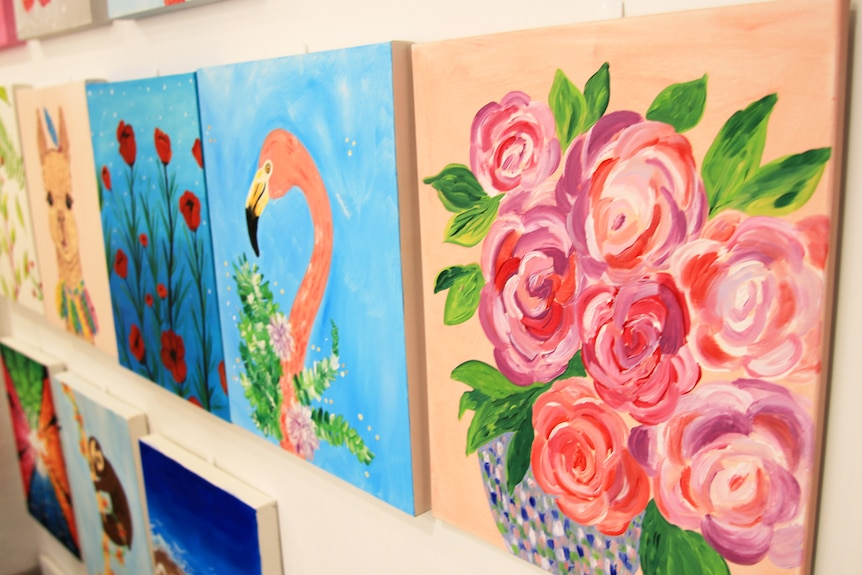 Artworks hang on a wall in Brooke Hughes' studio in Wollongong.