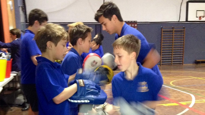 Students from St Pius X College in Sydney's north attend boxercise classes before school.