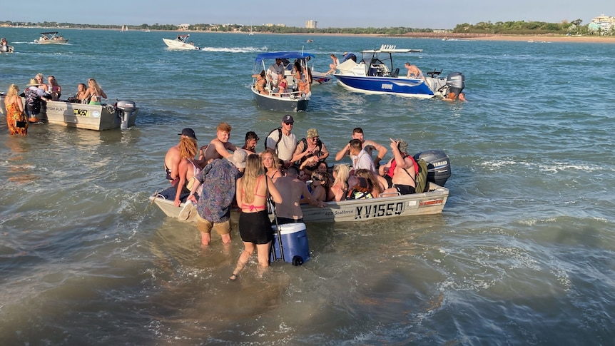 Four boats are crowded with people off the Darwin mainland.