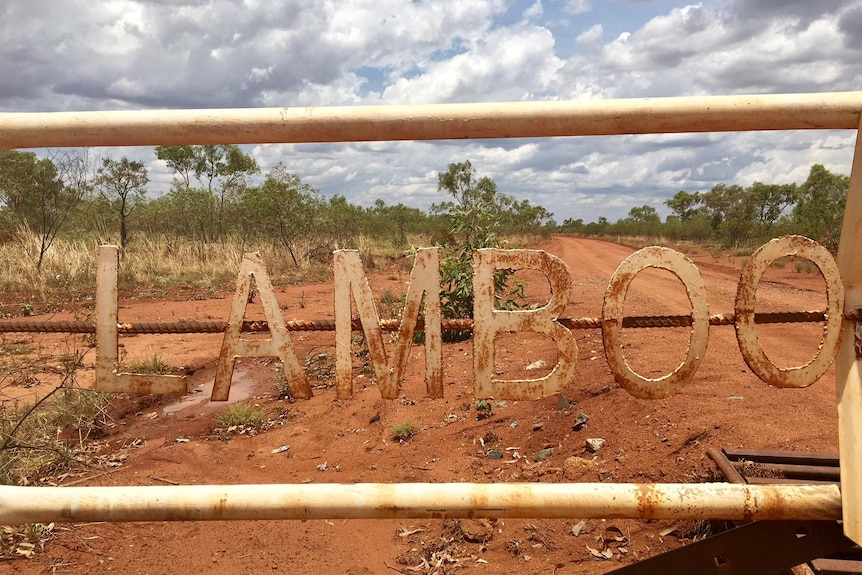 An outbreak property with a dirt road and a sign on the gate saying Lamboo Station
