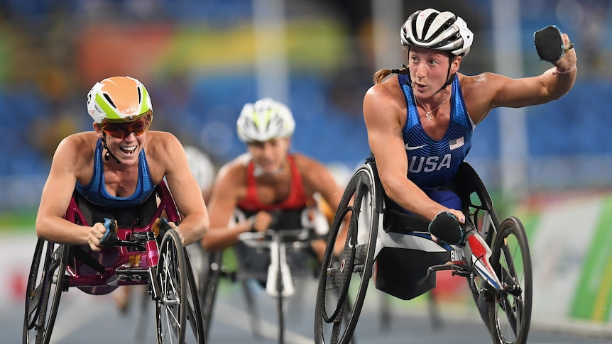 Two American wheelchair athletes celebrate after crossing the line to take gold and bronze in a 1,500m race.