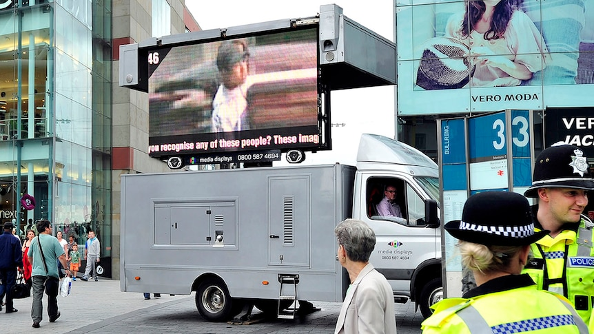 A van displaying images of people wanted in connection with the riots is pictured in Birmingham city centre on August 12, 2011.