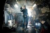 Boy in VR headset inside truck