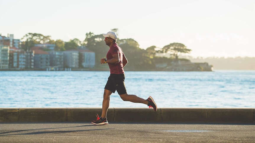 Man running past a body of water for an article about exercising during the coronavirus pandemic
