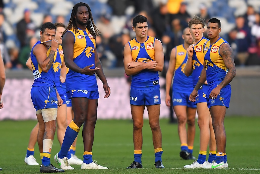Jamaine Jones, Nic Naitanui, Tom Cole, Brayden Ainsworth and Tim Kelly look dejected on the field after a loss