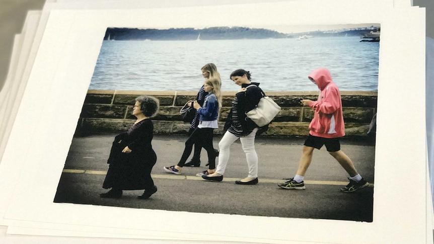 Debra Keenhan walking along with a woman looking down on her.