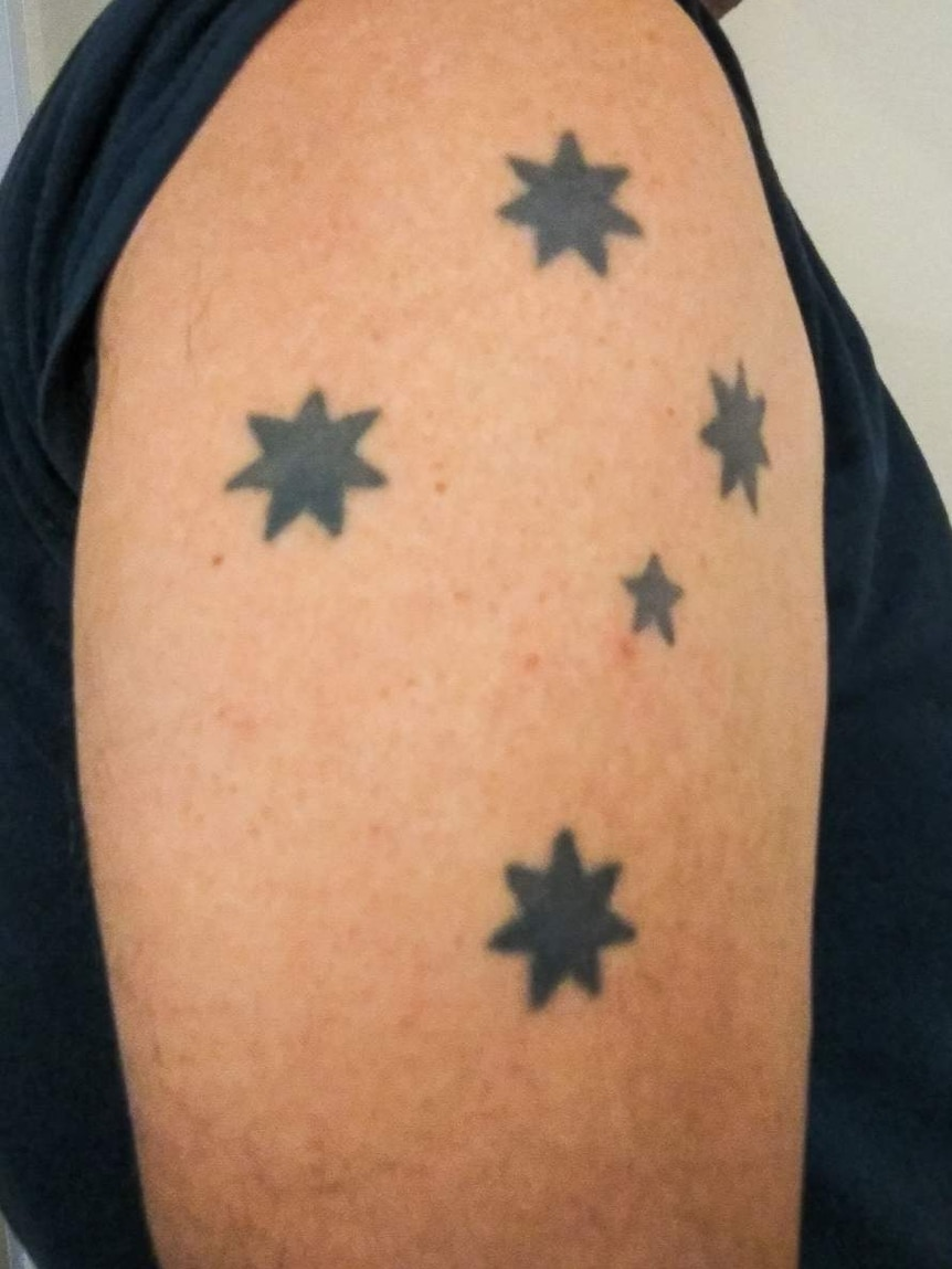 Southern Cross tattoo on shoulder.