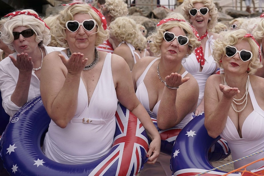 Marilyn Monroe impersonators blow kisses on Adelaide's Brighton beach.