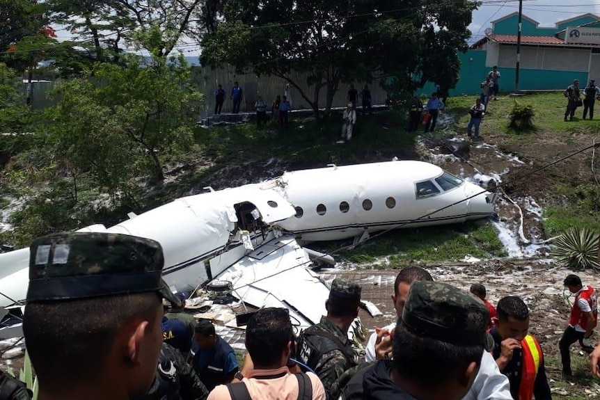 The remains of a private jet after it crashed in Honduras.