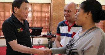 Duterte shakes hands with parents of Kian delos Santos