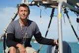 Craig Van Lawick sits on his boat