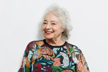 The artist Mirka Mora in a dress made by Gorman with her artwork as a print
