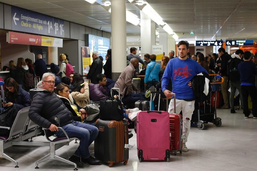 Passengers wait at Orly airport near Paris