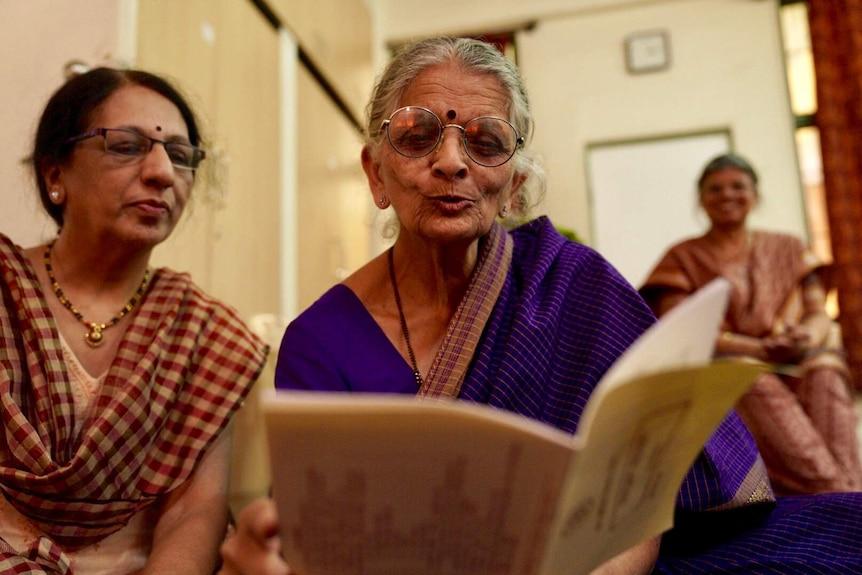 Sailja Joshi reading with fellow student