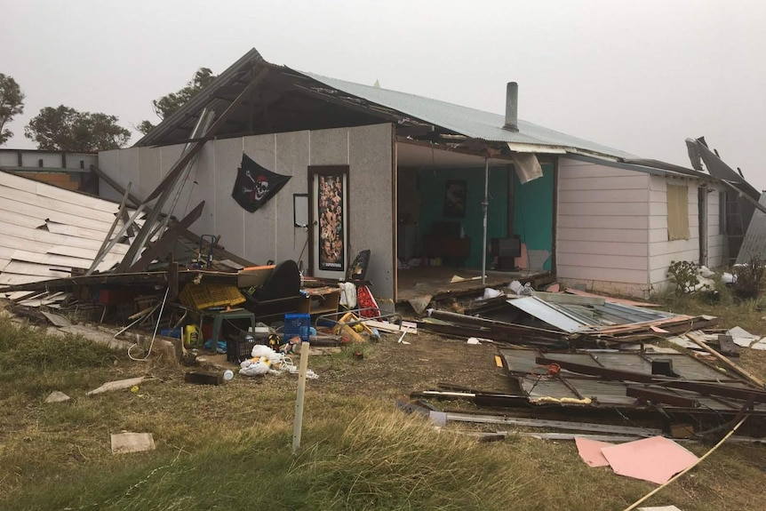 The exterior of a house exposed after strong winds destroyed the walls and roof