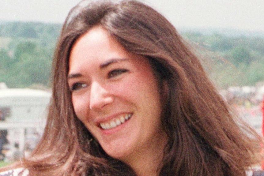 British socialite Ghislaine Maxwell smiles as she arrives at Epsom Racecourse.