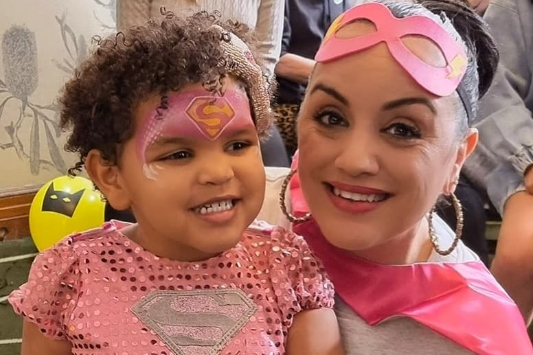 A woman and small girl dressed in pink super hero costumes, for a story on why The Wiggles new diverse members are so important.