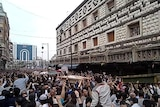 Thousands of Syrians attend a funeral in Homs