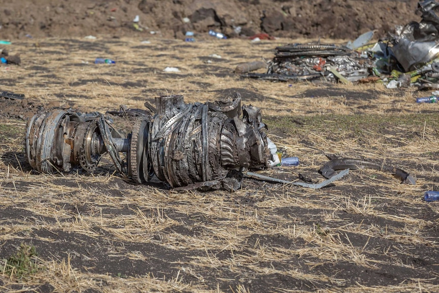 Metal scraps, that appear to be part of the Ethiopia Airlines propeller machinery, lie on the ground