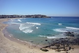Rips scatter a beach