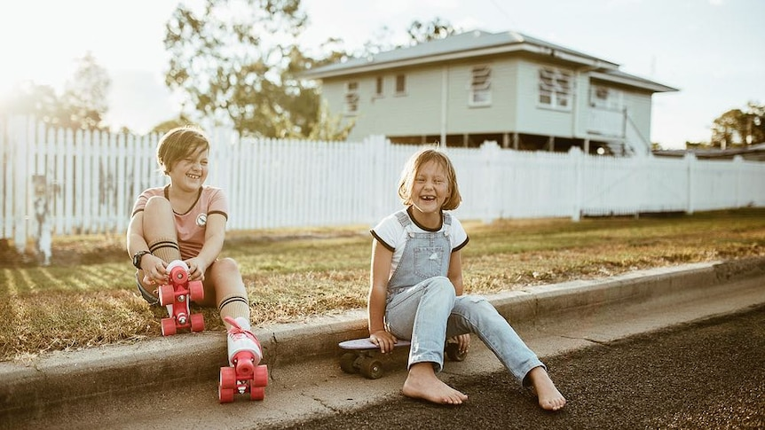 Two young girls enjoy some old-school skating fun in Texas, Queensland.