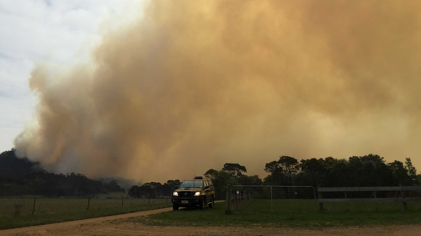 A fire burns in bushland in Tea Tree, north of Hobart