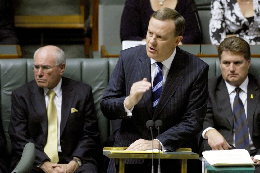 John Howard listens as Peter Costello delivers his 12th and final Federal Budget