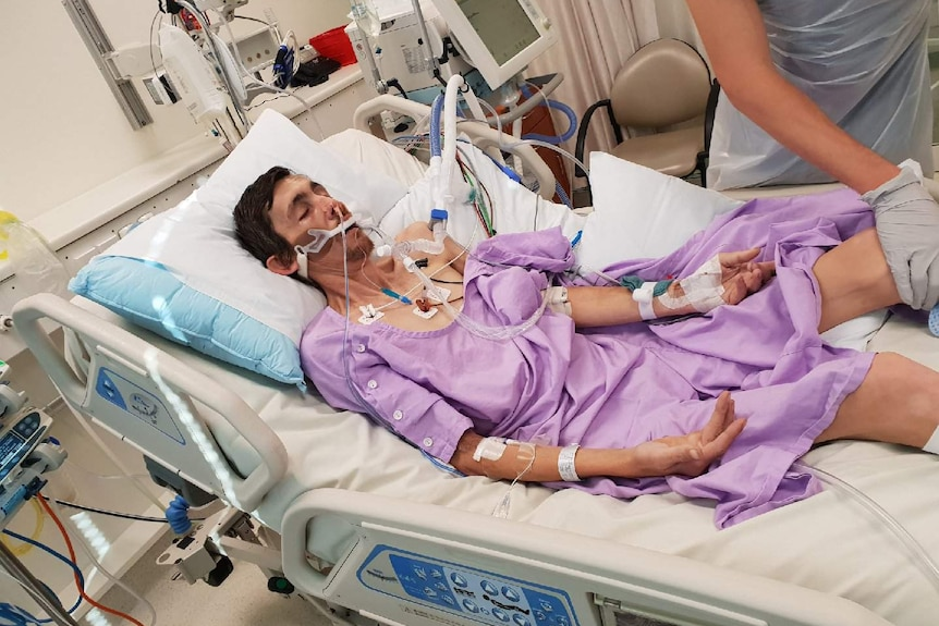 Gold Coast stonemason Anthony White lays in a hospital bed in intensive care.