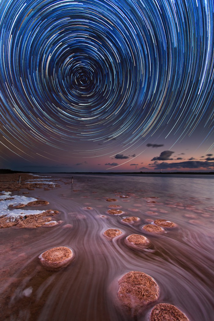 A star trail above a natural pool in Western Australia.